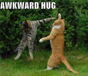 awkard hug